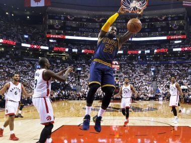 Cleveland Cavaliers forward LeBron James (23) slam dunks the ball against Toronto Raptors. AP