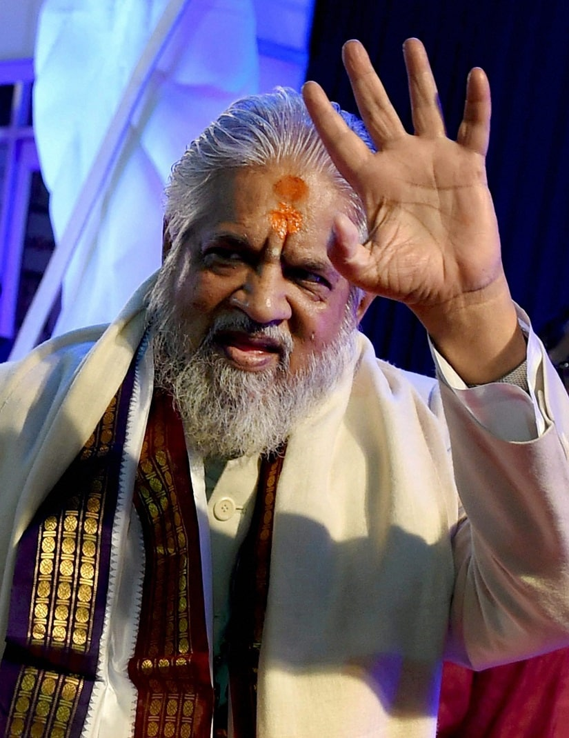"New Delhi: File Photo of Godman Chandraswami waves on the Red Carpet, during the celebrations of ""Aap Ki Adalat"" (AKA), who passed away after a prolonged illness in New Delhi on Tuesday. PTI Photo(PTI5_23_2017_000186B)"