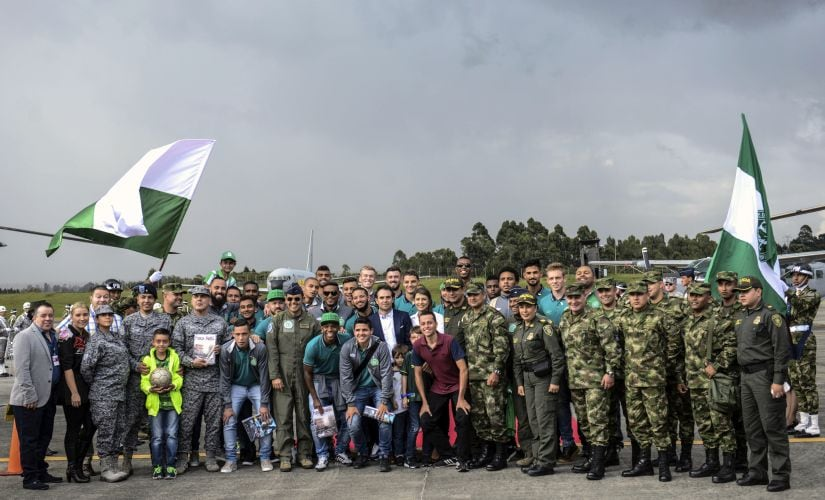 Chapecoense players pose for photos with members of the Colombian military on Monday. AFP