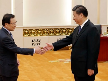 South Korean special envoy Lee Hae-chan, left, meets China's President Xi Jinping at the Great Hall of the People in Beijing on  Friday. AP