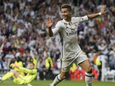 Real Madrid's Cristiano Ronaldo celebrates after scoring his second goal against Atletico. AFP