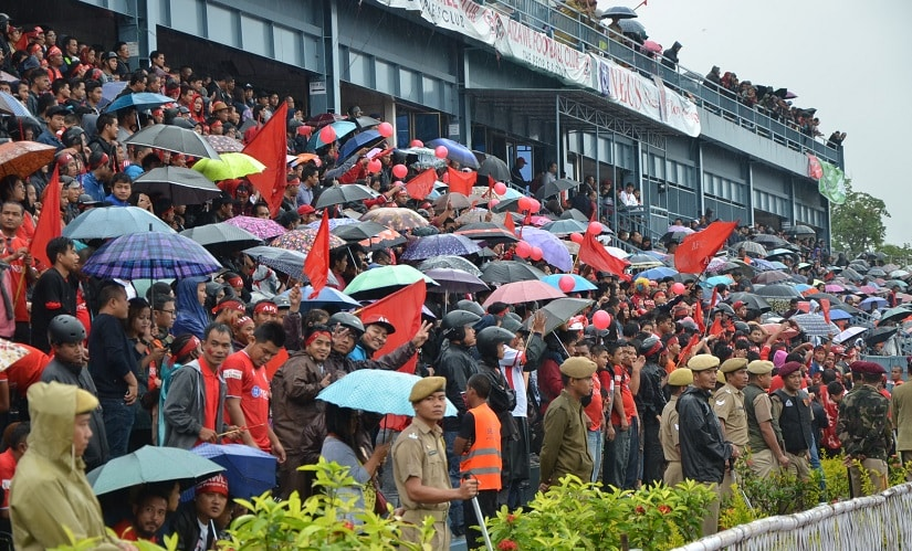 When Aizawl hosted Mohun Bagan, rain and mist made the viewing uncomfortable. But try telling that to these fans who packed the stadium in Aizawl. Image courtesy: AIFF media