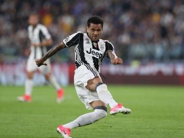 Juventus defender Dani Alves kicks to score during the Champions League semi-final against Monaco. AFP