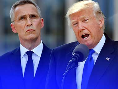 U.S. President Donald Trump, right, speaks as NATO Secretary General Jens Stoltenberg looks on during ceremony at NATO headquarters at the NATO summit in Brussels. AP