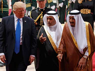President Donald Trump walks with Saudi King Salman during a welcome ceremony at the Royal Terminal of King Khalid International Airport in Riyadh. AP