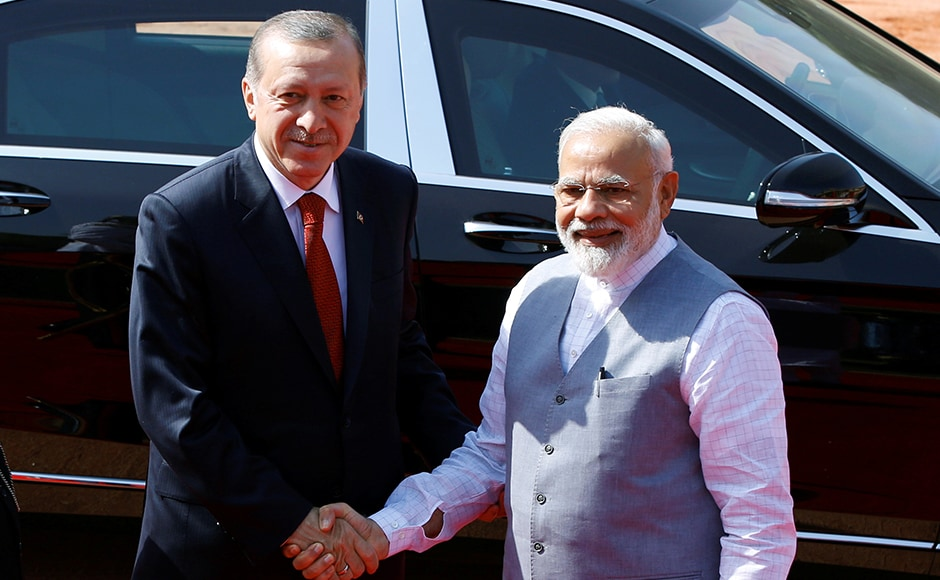 Turkish President Recep Tayyip Erdogan shakes hands with India's Prime Minister Narendra Modi (R) during his ceremonial reception at the forecourt of Rashtrapati Bhavan presidential palace in New Delhi on Monday. Reuters