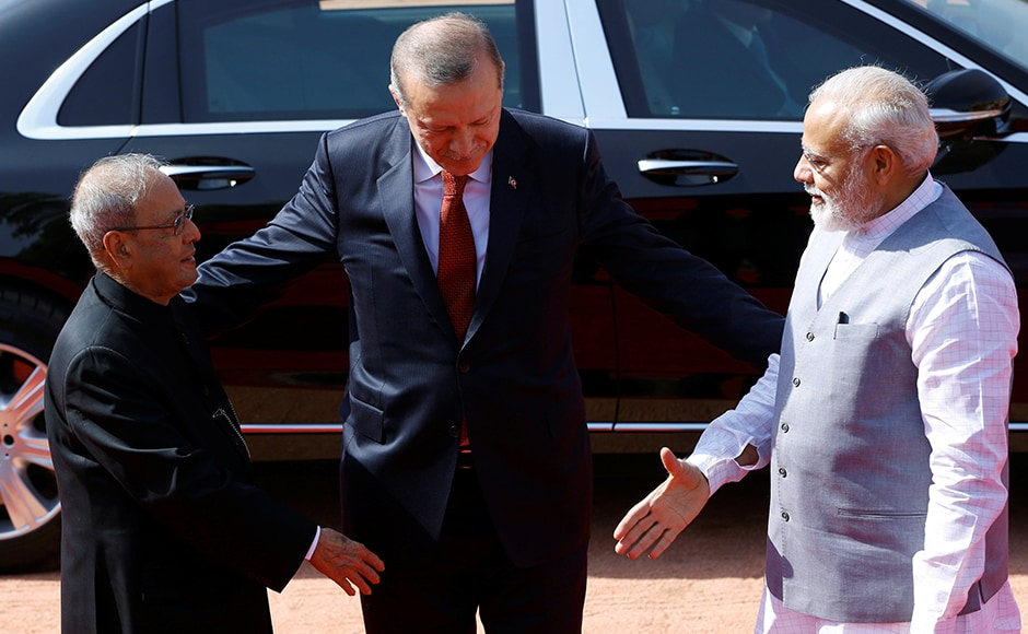 India's Prime Minister Narendra Modi and Indian President Pranab Mukherjee (L) with Turkish President Recep Tayyip Erdogan (C), during Erdogan's ceremonial reception at the forecourt of India's Rashtrapati Bhavan presidential palace in New Delhi on Monday. Reuters