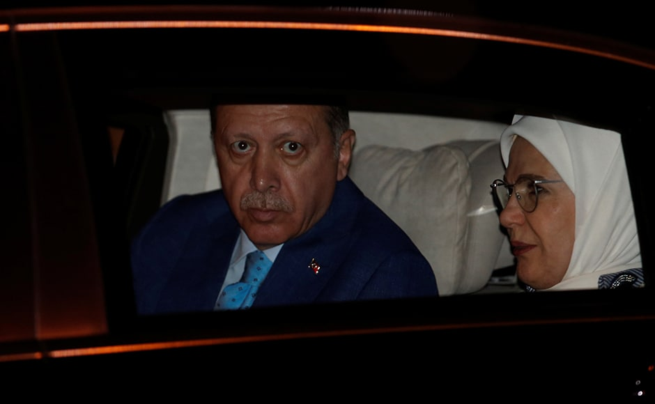 Turkish President Tayyip Erdogan and his wife Emine Erdogan sit inside their car after their arrival at the airport in New Delhi on Sunday. Reuters