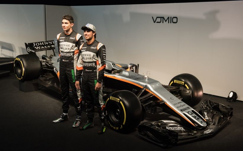 Sahara Force India's drivers Sergio Perez (R) and Esteban Ocon (L) during the launch of their 2017 car. AFP
