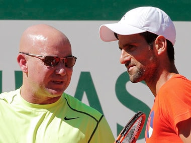 Novak Djokovic listens to his new coach Andre Agassi during a training session for the French Open. AP