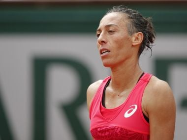 Francesca Schiavone reacts after losing to Garbine Muguruza at the French Open. AP Photo