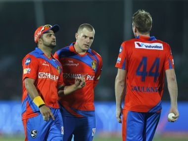 Gujarat Lions captain Suresh Raina with James Faulkner and Aaron Finch during the match against Delhi. Sportzpics