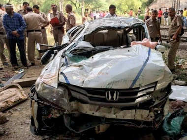 The car which fell off the Delhi flyover on Monday. PTI