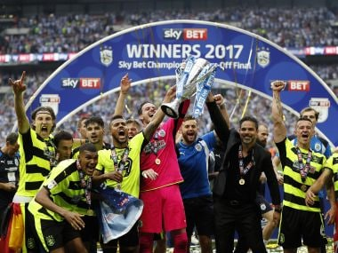 Huddersfield Town manager David Wagner and players celebrate after winning the play-off final. Reuters
