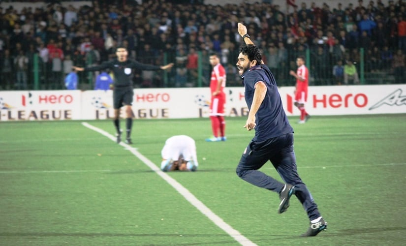 Aizawl FC coach Khalid Jamil runs on to the pitch after the final whistle in the game against Shillong Lajong. Image courtesy: AIFF media