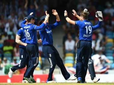 England's Chris Woakes (#19) celebrates with teammates after dismissing West Indies cricketer Kraigg Brathwaite England's Ben Stokes dives to field the ball during the final of the three-match One Day International series between England and West Indies, at the Kensington Oval Stadium in Bridgetown, Barbados, on March 9, 2017. England leads the series 2-0. / AFP PHOTO / Jewel SAMAD