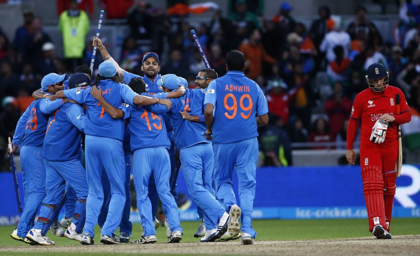 India's team celebrate victory as England's James Tredwell (R) walks away during their ICC Champions Trophy final in 2013. Reuters