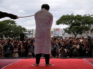 An Indonesian man is publicly caned for having gay sex, in Banda Aceh. Reuters