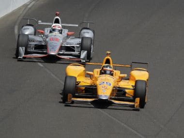 Fernando Alonso, of Spain, leads Will Power, of Australia, into the first turn in the opening laps of the Indianapolis 500 auto race at Indianapolis Motor Speedway, Sunday, May 28, 2017, in Indianapolis. (AP Photo/R Brent Smith)