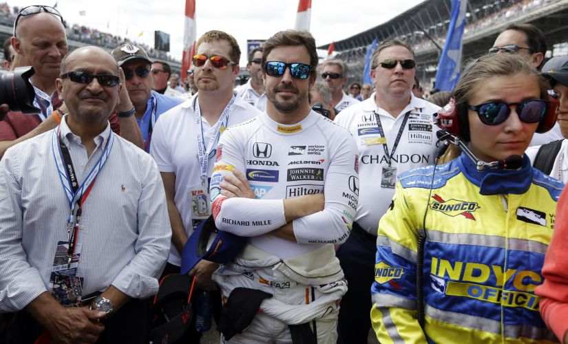 Fernando Alonso waits near his car for the start of the Indianapolis 500. AP