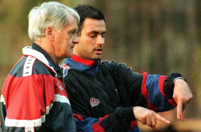 File photo of Barcelona coach Bobby Robson (L) listening to second coach Jose Mourinho during a training session at Nou Camp. Reuters