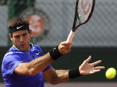 Juan Martin Del Potro returns the ball to Guido Pella during their first round match. AP