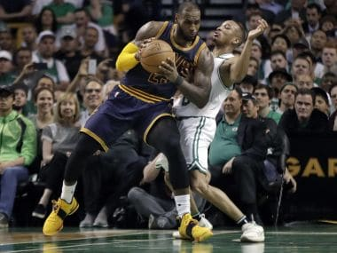 Cleveland Cavaliers' LeBron James, left, muscles his way to the basket on Friday. AP