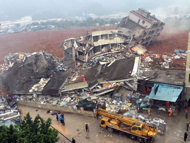 Rescuers search for survivors amongst collapsed buildings after the landslide in Shenzhen. AP
