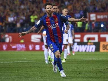 Barcelona's Argentinian forward Lionel Messi celebrates after scoring the opener during the Spanish Copa del Rey (King's Cup) final football match FC Barcelona vs Deportivo Alaves at the Vicente Calderon stadium in Madrid on May 27, 2017. / AFP PHOTO / Josep LAGO