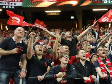 Manchester United's fans celebrate during the UEFA Europa League final football match Ajax Amsterdam v Manchester United on May 24, 2017 at the Friends Arena in Solna outside Stockholm. / AFP PHOTO / SOREN ANDERSSON