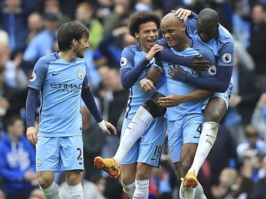 Manchester City's Vincent Kompany celebrates scoring his side's second goal. AP