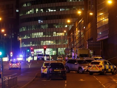 Vehicles are seen near a police cordon outside the Manchester Arena, where U.S. singer Ariana Grande had been performing, in Manchester. Reuters