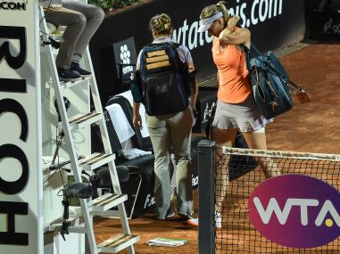 Maria Sharapova leaves the court after retiring hurt in the match against Mirjana Lucic-Baroni. AFP