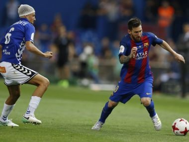 Barcelona's Lionel Messi, right, takes the ball past Alaves' Marcos Llorente during the Copa del Rey final soccer match between Barcelona and Alaves at the Vicente Calderon stadium in Madrid, Spain, Saturday, May 27, 2017. (AP Photo/Francisco Seco)