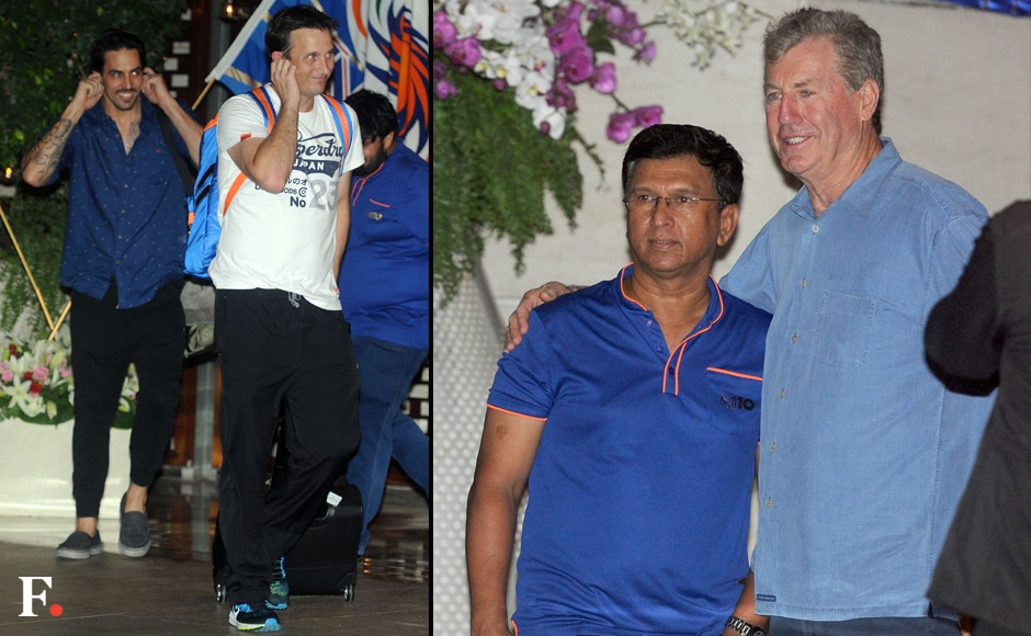 Mictchell Johnson with Shane Bond and Kiran More with John Wright at the party. Sachin Gokhale/Firstpost