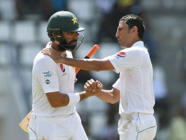 Pakistan captain Misbah-ul-Haq (L) is consoled by teammate and fellow retiree Younis Khan. AFP