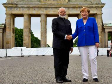 Narendra Modi and Angela Merkel in Berlin on Tuesday. PTI