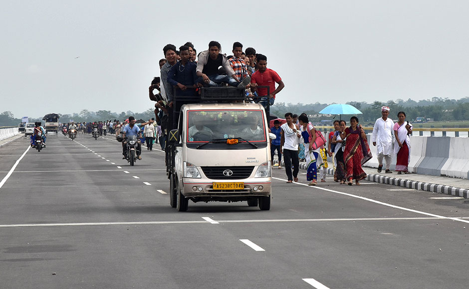 People travel on the Dhola-Sadiya bridge across the River Lohit, a tributary of the River Brahmaputra, which was inaugurated by Indian Prime Minister Narendra Modi in Assam on May 26, 2017. The 9.15-kilometre-long bridge to connect Assam state with Arunachal Pradesh is the longest bridge in India. AFP