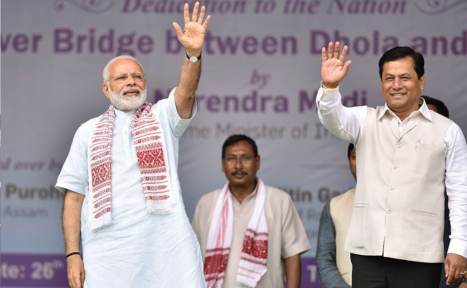 Indian Prime Minister Narendra Modi (L) and Sarbananda Sonwal, chief minister of Assam state, wave to the crowd as they inaugurate the Dhola-Sadiya bridge across the River Lohit, a tributary of the River Brahmaputra, in Assam on May 26, 2017. The 9.15-kilometre-long bridge to connect Assam state with Arunachal Pradesh is the longest bridge in India. AFP
