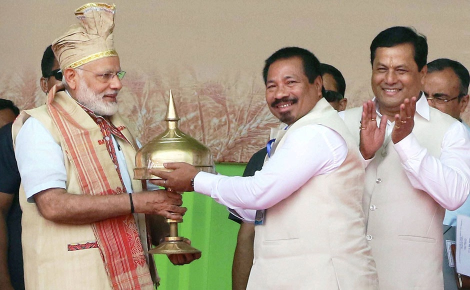 Dhemaji: Prime Minister Narendra Modi being presented a Sorain by Assam Agriculture Minister Atul Bora during the foundation stone laying program of an Indian Agricultural Research Institute (IARI) at Gogamukh in Dhemaji district on Friday. PTI