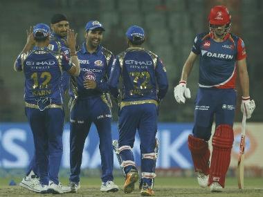 Mumbai Indians celebrate the dismissal of Pat Cummins. Sportzpics