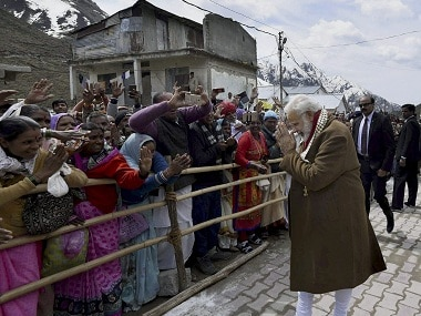 Narendra Modi greets people after offering prayers at the Kedarnath Temple. PTI
