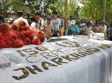 CRPF offcials display explosives recovered from Lohardagga (Jharkhand) during search operation. PTI