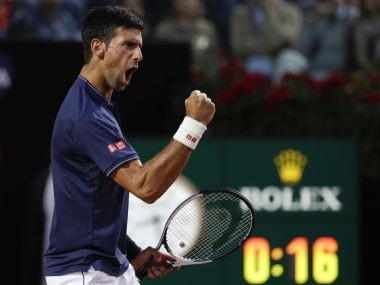 Novak Djokovic celebrates after winning a point against Dominic Thiem. AP