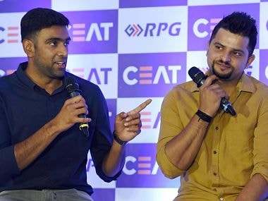 R Ashwin and Suresh Raina during the CEAT Cricket Awards in Mumbai. PTI