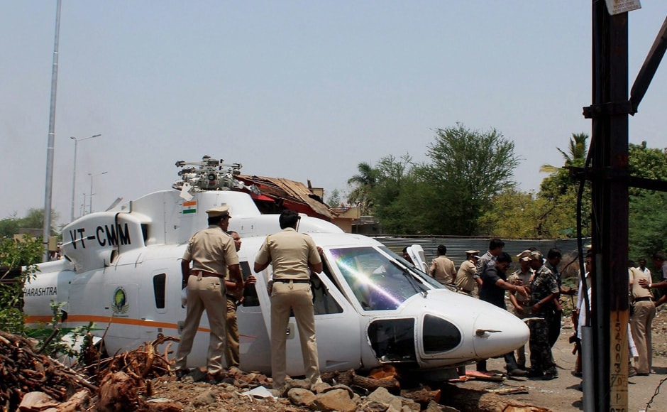 The helicopter, which had six persons on board including two crew members, got entangled in overhead wires while landing at Nilanga area where the chief minister had held a programme. PTI