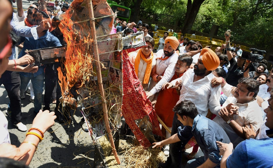 BJP workers demanded an apology from Congress president Sonia Gandhi and the arrest of Congress leaders involved in slaughtering the calf in Kerala. They also burnt effigies of Sonia and Congress vice-president Rahul Gandhi. PTI