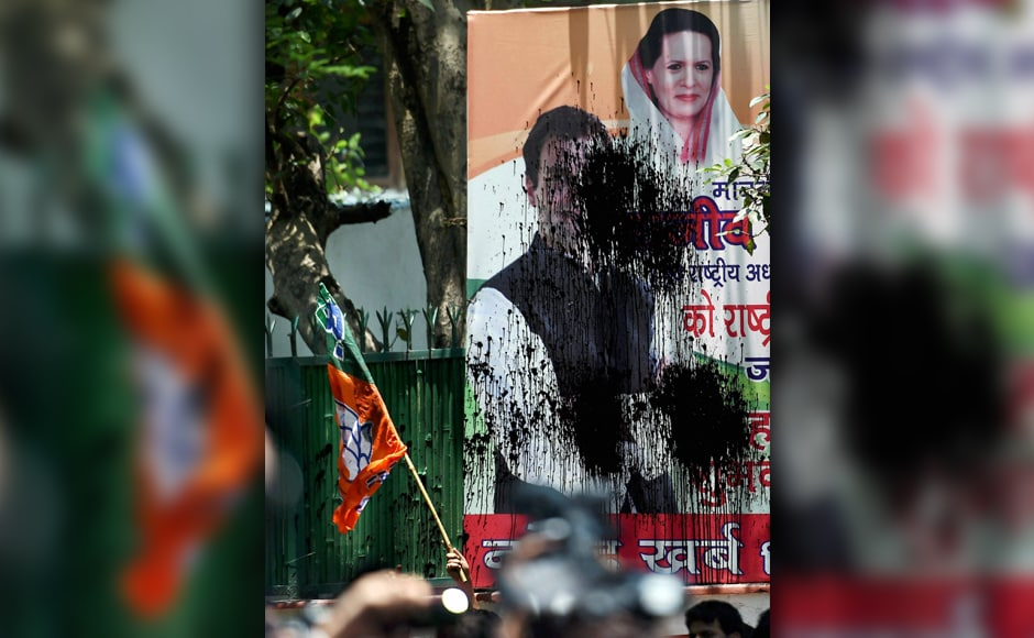 Members of Bhartiya Janta Yuva Morcha on Tuesday held a protest outside Congress headquarters in Delhi. They were protesting against the slaughter of a calf by Congress' youth wing workers in Kerala. They also blackened the poster of Congress leaders. PTI