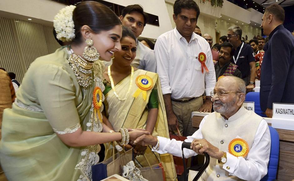 Sonam Kapoor greets Telugu filmmaker K Vishwanath as Surabhi CM looks on. PTI