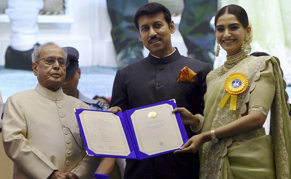 Pranab Mukherjee and Rajyavardhan Singh Rathore present Best Hindi Film Award to Sonam Kapoor for Neerja. PTI